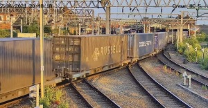 Containers on rail passing through Crewe, UK
